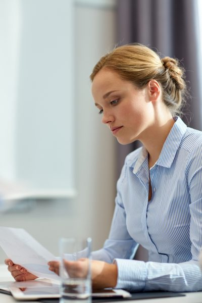 businesswoman concentrating on payroll HR and HR Administration at her desk
