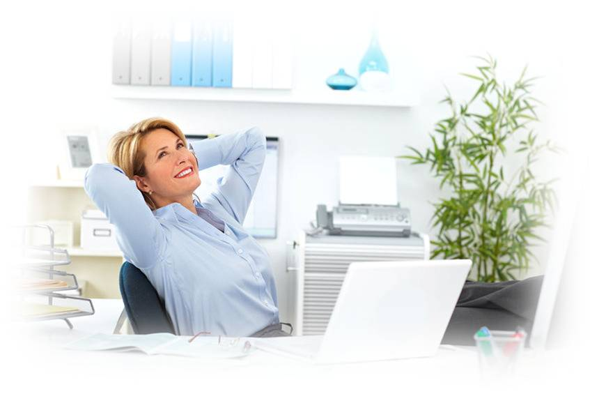 happy satisfied executive female leaning back in chair